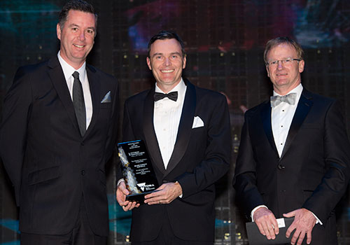 Major Furnace Australia Managing Director, Andrew North (centre), accepts his award from , the Minister for Industry and Employment, Wade Noonan (left), and Ai Group Victorian Head, Tim Piper (right)